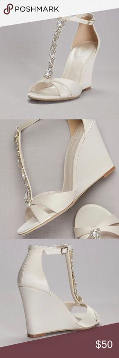 """Wedding Wedge Shoes A crystal strand embellishes the vamp of towering satin T-straps wedges. By David's Bridal Synthetic 3.25"""" wedge Adjustable buckle Ivory color Lulu Shoes Wedges"""