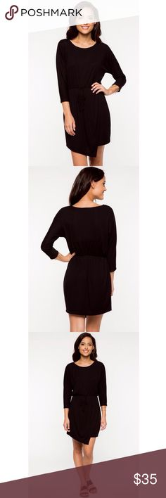 Front Tie Jersey Dress Ribbed jersey dress with three-quarter sleeves and asymmetric front panel. Great for daytime or evening.   Fabrication: 62% Polyester / 34% Rayon / 4% Spandex Hand wash Model is wearing size S Made with love in the USA Everly Dresses