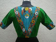 Stunning kutch work blouses in raw silk. Lovely green color raw silk designer blouse with hand embroidery thread work. Brocade Blouse Designs, Simple Blouse Designs, Designer Blouse Patterns, Blouse Neck Designs, Kurta Designs, Sleeve Designs, Zardozi Embroidery, Embroidery Thread, Saree Blouse Models