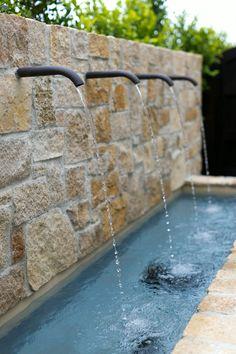 Seaward Road - Cream Delta Stone fountain with simple spouts, Photo credit, nicholasgingold.com