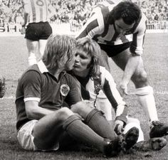 I1974. Leicester City were down 4-0 against Sheffield United. The game was into the dying stages, and Leicester's Alan Birchenall was running for the ball. He collided with Sheffield player Tony Currie, and both went down and shared a kiss. The tabloids went in to overdrive in their reaction.