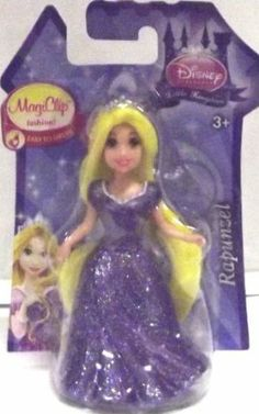"""Disney Princess Little Kingdom MagiClip Fashion Rapunzel Doll by Mattel. $7.99. Includes: Disney Princess Little Kingdom MagiClip Fashion Rapunzel Doll and Snap-On Dress. Dimensions: Approximately 3.75"""" Tall. Easy to dress!. Ages 3+. Features Disney Princess Little Kingdom MagiClip Fashion Rapunzel Doll and Snap-On Dress. Dimensions: Approximately 3.75"""" Tall. Easy to dress! Ages 3+"""