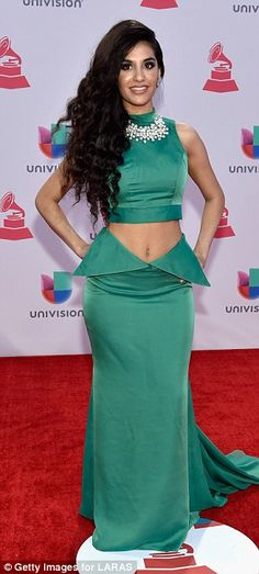 Cool and coral: WhileJulieta Rada rocked a two-piece teal-green number,Jessica Cediel caught the eye in a very low-cut shimmery coral gown