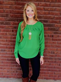 What a beautiful fall shade of green this top is! This top has a beautiful see through top to bottom lace detail in the back with a slightly pleated neckline! Skinny jeans, the right jewelry, and boots will complete this fall outfit! Our model is wearing a small! 100% Polyester