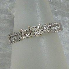Three Stone Diamond Engagement Ring set in 14k White Gold. .75 Carats Total Princess Cut Diamond Weight. $500.