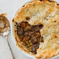 Meaty stew under a flaky crust—beef pot pie is as comforting as it gets. Could we revive, and reinvigorate, this satisfying one-dish dinner? Pie Recipes, Casserole Recipes, Cooking Recipes, Freezer Cooking, Kitchen Recipes, Freezer Meals, Cooking Time, Delicious Recipes, Beef Pot Pies
