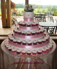 """- Wedding Cupcakes - Chocolate, Vanilla & Red Velvet with cream Cheese Filling. Topped with Buttercream Icing, Pink Fondant Flowers and 6"""" Top Cake"""