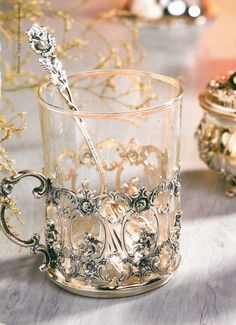 "Russian Tea Glass Holders called podstakannik (Russian: подстака́нник, literally ""thing under the glass""), or tea glass holder. Their primary purpose is to be able to hold a very hot glass of tea, which is usually consumed right after it is brewed. Hildesheimer Rose, Coffee Cups, Tea Cups, Coffee Beans, Russian Tea, Russian Style, Teapots And Cups, My Cup Of Tea, Cup And Saucer"