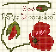 X stitch poppy (Not sure what the French says, if anybody can tell me!). Freebie. Very apt for this month.......