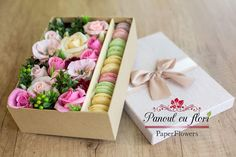 Paperflowers arrangement with sweet macarons