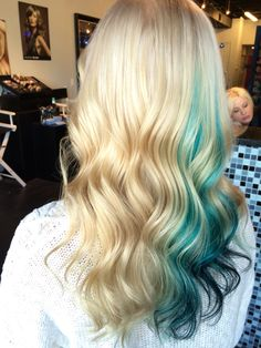 My new icy blonde with a teal ombré peekaboo. By Gina at Luxe VIP Hair Room.