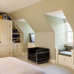 Dormer window seats - I like the way this is made to look like an armchair; also like the drawer for storage underneath