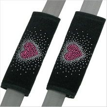 Make your drive more comfortable with pretty rhinestone red heart seat belt shoulder pads. Available at CarDecor.com.