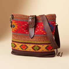"""SOUTH OF THE PECOS BAG�--�Multicultural messenger bag in soft distressed brown leather sports a wool tapestry front inspired by Aztec designs. Buckled snap closure, fabric lining, one pocket. Made in USA. 14""""W x 2-1/4""""D x 12-3/4""""H."""