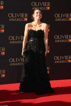 Classic: Actress Billie Piper brought classic glamour to the event, donning a fitted strapless black feather-adorned dress