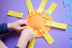 Button on the �sun rays� (long rectangle strips cut from yellow felt) onto the �sun�. Great motor skills activity for toddlers and preschoolers - Happy Tot Shelf