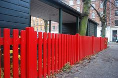 Red picket fence by astridmn, via Flickr