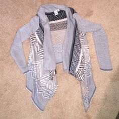 Sweater Gray Sweater. Only worn once. Love the sweater it's just a little short on me in the back because I have a long torso. Make an offer, price is negotiable! Sweaters Shrugs & Ponchos