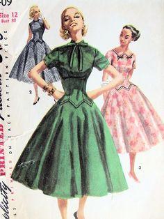 1950s SIMPLICITY PATTERN 1409 PRETTY LONG LINE BODICE DRESS, FULL FLARED SKIRT, 3 NECKLINE STYLES