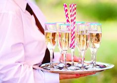 Rose water and champagne with a rim of colored sugar and paper straws... SO cute!