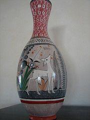 Tonala Venado Florero A typical scene used in Tonala pottery, glaze burnished with pyrite.