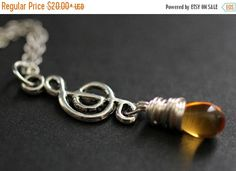 SUMMER SALE Musical Treble Clef Necklace. Silver Music Necklace. Treble Clef Teardrop Necklace. (CHOOSE Your Color) Handmade Jewelry. by StumblingOnSainthood from Stumbling On Sainthood. Find it now at http://ift.tt/28Oob1M!