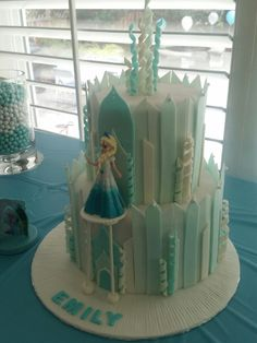 Frozen Castle Cake with a platform for Elsa. Chocolate cake with chocolate buttercream.