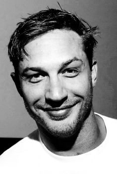 Tom Hardy with a mischievous grin