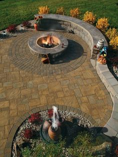 Stamped Concrete Patio with Landscaping Wall Retaining Wall... love the water feature and fire pit