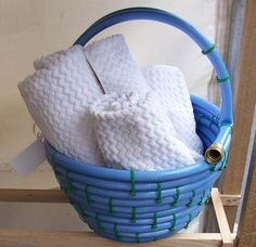 an old garden hose turned basket, cute!
