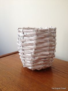 Woven paper basket made from recycled newspapers - great cost effective recycling project!  Visit us at www.millenniumwasteinc.com for more information about recycling and waste management.