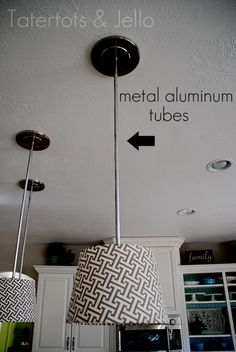 She used conversion kit from Lowes, but covered the wire hanging down with spray painted metal tubes.