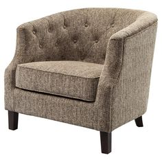 Set this classic barrel-style arm chair in a corner to create a cozy reading nook, or use it at the head of your dining table for a chic touch. Showcasing bu...