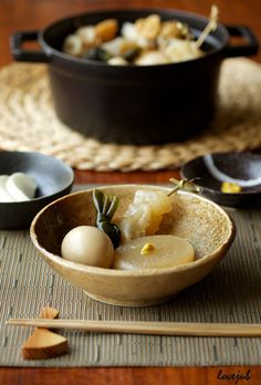 Oden おでん -  Japanese winter dish consisting of several ingredients such as boiled eggs, daikon radish, konnyaku, and processed fish cakes stewed in a light, soy-flavored dashi broth.
