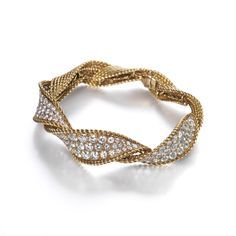 Sterle Diamond Bracelet. A pave diamond set twisted bangle mounted in 18ct yellow gold.     French, circa 1940.