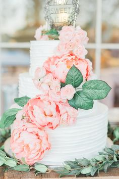 """Cascading large pink florals, romantic wedding cake, black """"how sweet it is"""" cake topper // Karly Richardson Photography"""