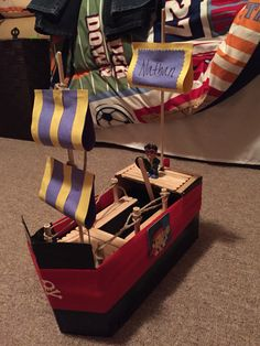 I made this for my 3yr old's Valentine party. Used: Kleenex box & parts of another box. Black duck tape, Popsicle sticks, small rope, construction paper, wooden sticks (I found all of this in the craft big, hot glue & elmers. Props were my son's toys.