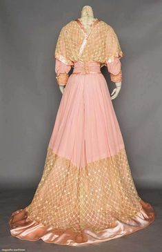 PINK SILK & LACE TEA GOWN, c. 1908. 2 piece, pink satin, bodice & wide hem band of cream lace, tulle high neck insert. Back