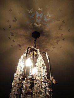 Moths around a light. - Design Inspiration. Planet Stencil Library.