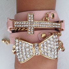 Rhinestone cross and over-sized bow