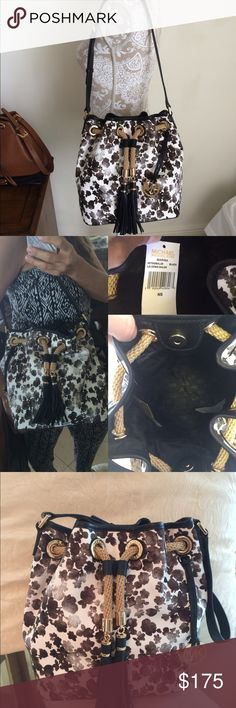 Michael Kors Jules NWT!! Printed Beautiful Michael Kors canvas handbag. Trendy  floral printed canvas in black and cream color. Handle is in black leather and adjustable. Brand new with tag attached. No trades Michael Kors Bags Shoulder Bags