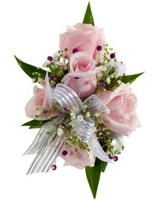 DECORATED ROSE CORSAGE, PINK - A corsage with five pink sweetheart roses and babies breath decorated with three dark pink rhinestone sprays and a white & silver bow. Designed as a wrist corsage, but can be converted to a pin on corsage with included pins. Item #4412.
