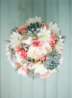 The bridal bouquet will be white hydrangeas, muted green succulents, peachy pink spray roses, and hints of gray dusty miller wrapped in frayed linen with the stems showing.