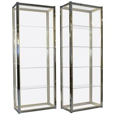 Pair of Brass and Chrome Display Units in the Manner of Romeo Rega | From a unique collection of antique and modern shelves at https://www.1stdibs.com/furniture/storage-case-pieces/shelves/