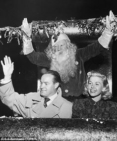Bob Hope is seen with actress Helen Wood, left, in this 1938 gagshot of him climbing out of a chimney. Right: Bob Hope and and Doris Day in Hollywood in 1948. the day before he performed in Berlin for troops working on the airlift