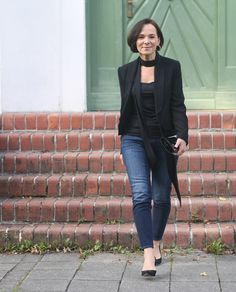 Party look in jeans, black blazer and a skinny scarf