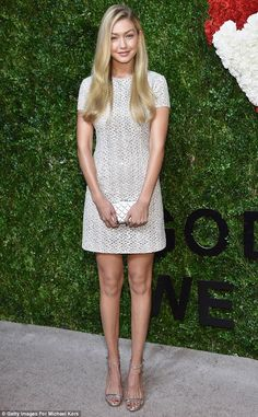 Model of the moment: Gigi Hadid showed off her long, slender legs in a short silver frock as she attended the God's Love We Deliver, Golden Heart Awards in New York City