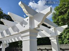 Wow!  This White Pine Hampton's Style Pergola Arbour turned out even better than expected!  It's striking features include a thicker Pine beam and rafter which emanate a commanding presence at the end of the pool.   The large posts with hand made corbels and architrave boxes match the house providing a fluency in design throughout the residence and outdoor structure.   See more pictures and design aspects at gardenenvi.com and make sure you call us to build your next Pergola Arbour!   Die Hamptons, Hamptons Style Homes, Hamptons House, Timber Pergola, Timber Roof, Pergola With Roof, Hampton Pool, Hampton Garden, Pergola Designs