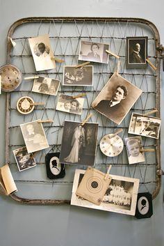 Using clothes pins to hang pictures on wall (which is actually an old crib mattress spring frame!)