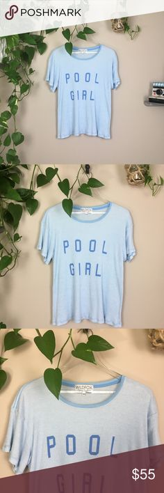 "WILDFOX✨pool girl tee WILDFOX pool girl Manchester tee. Baby blue in color. Ribbed fabric. This particular shirt doesn't have a fabric tag and had the ""sample"" tag cut out.  Fabric shows slight signs of wear—meant to look worn/broken in😎 Size small. Oversized fit.    👊🏼no trades ✨Thank you so much for shopping my closet! Shop around my other listings for one of a kind items.🦄 Wildfox Tops Tees - Short Sleeve"